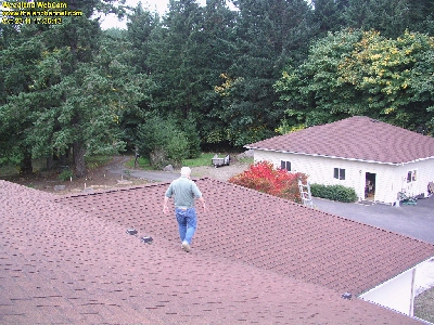 Camera took picture of me walking on our roof after making adjustments to enclosure of new Cam